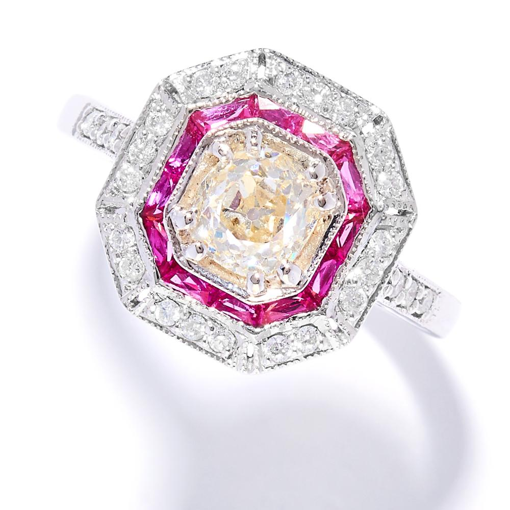 DIAMOND AND RUBY DRESS RING in 18ct white gold, in Art Deco design, set with an old cut diamond of approximately 0.88 carats in a border of baguette cut rubies and round cut diamonds, stamped 18K, size N / 6.5, 4.39g.