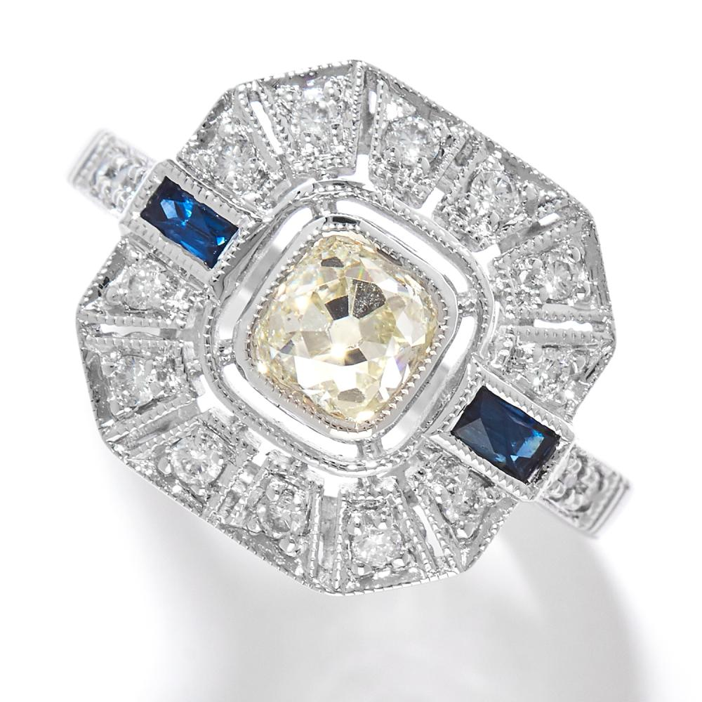 DIAMOND AND SAPPHIRE DRESS RING in 18ct white gold, in Art Deco design, set with an old cut diamond of approximately 0.82 carats, with further round cut diamonds and French cut sapphires, stamped 18K, size N / 6.5, 4.95g.