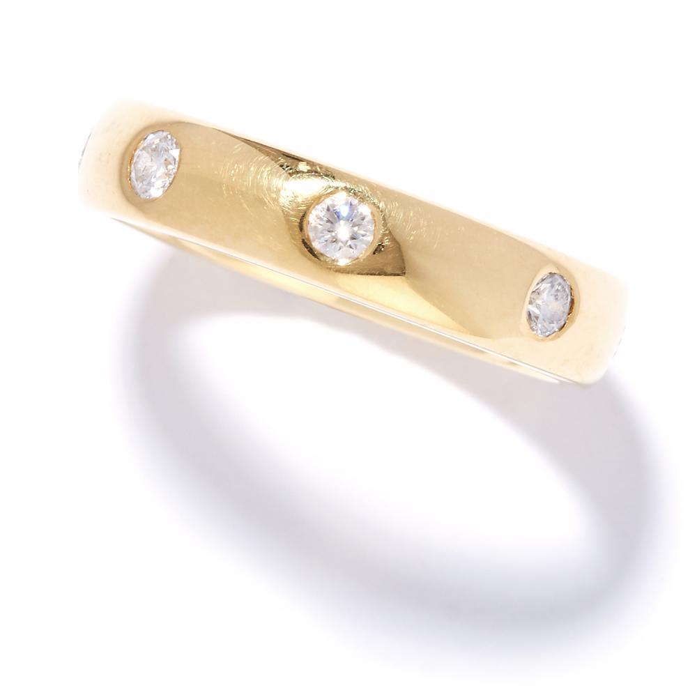 DIAMOND ETERNITY BAND RING in 18ct yellow gold, set with eight round cut diamonds, British hallmarks, size K / 5, 5.03g.