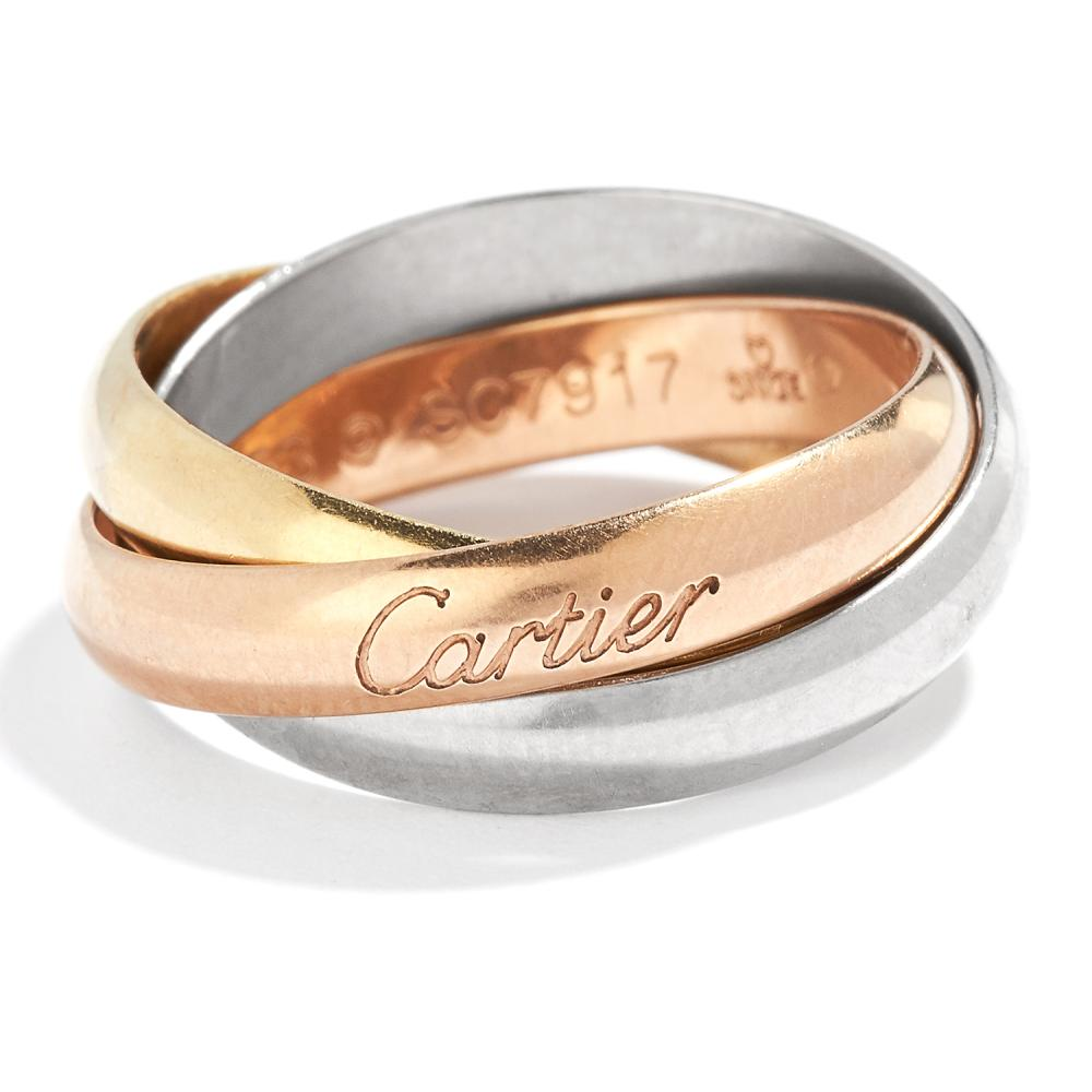 TRINITY DE CARTIER WEDDING BAND RING, CARTIER in 18ct gold, formed of three interlocking bands in yellow, white and rose gold, signed Cartier and numbered, stamped 750, size M / 6.25, 8.5g.