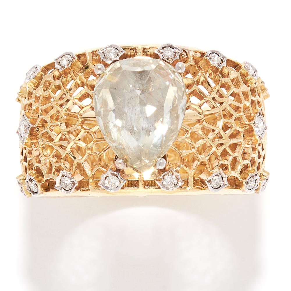 VINTAGE DIAMOND DRESS RING in 18ct yellow gold, the large band with openwork design, set with a pear shaped rose cut diamond of 10.85mm further accented by round cut diamonds, stamped 750, size M / 6.5, 9.0g.