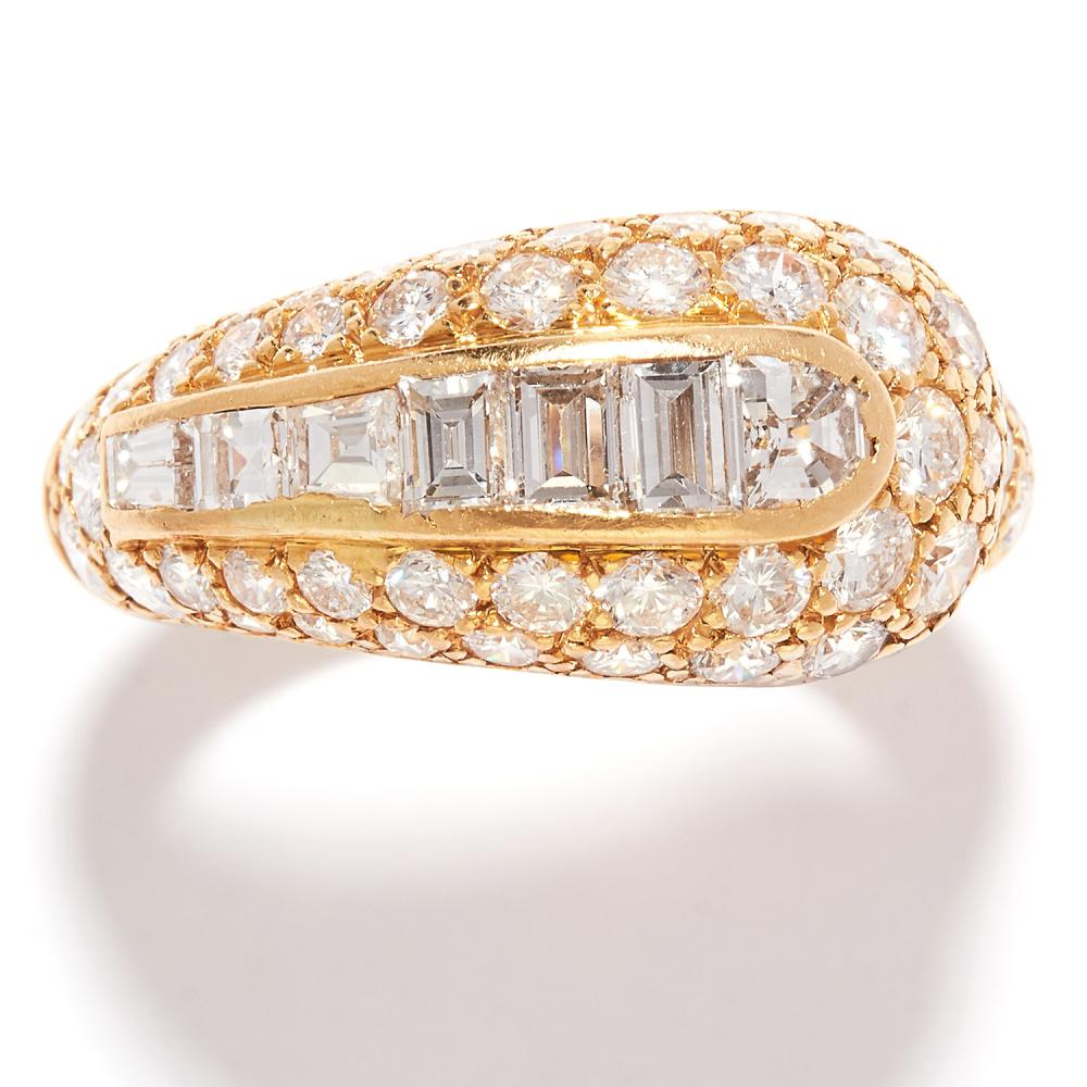 VINTAGE DIAMOND DRESS RING, BOUCHERON in 18ct yellow gold, the graduated, coiled band jewelled with round, step and fancy cut diamonds, signed Boucheron and numbered, French marks, size O / 7.25, 5.8g.