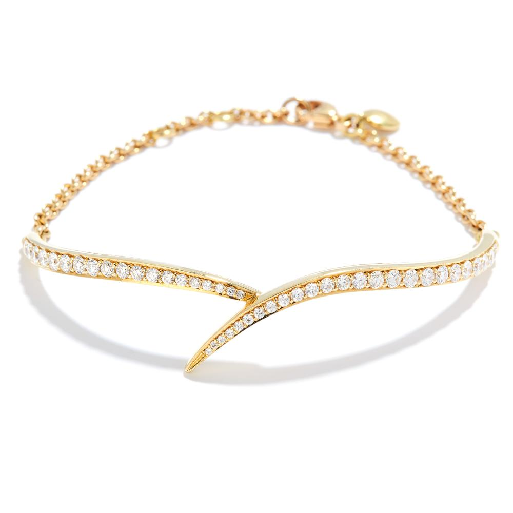 DIAMOND BRACELET, SEANE LEANE in 18ct yellow gold, set with a row of round cut diamonds in half bangle form, British hallmarks, 12.32g.