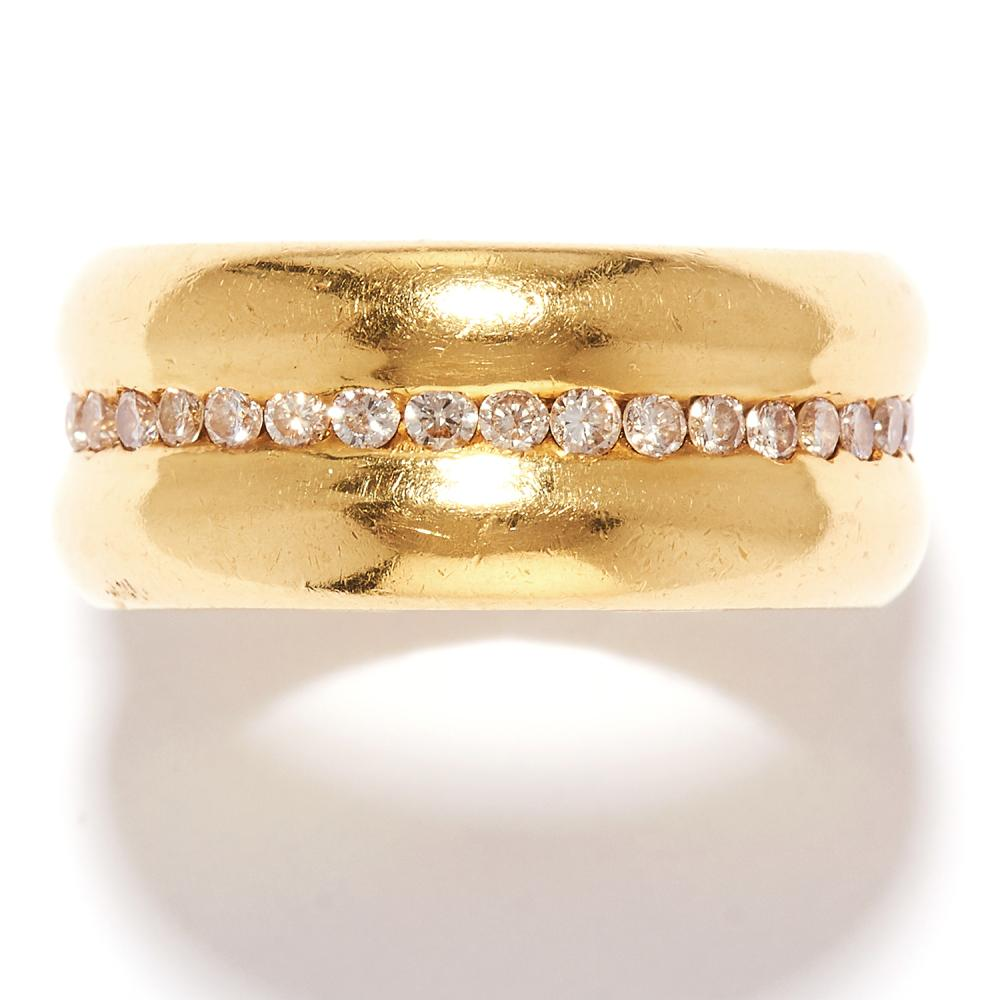 DIAMOND ETERNITY BAND RING in 18ct yellow gold, the double band with a row of round cut diamonds, stamped 18K, size P / 7.5, 13.6g.