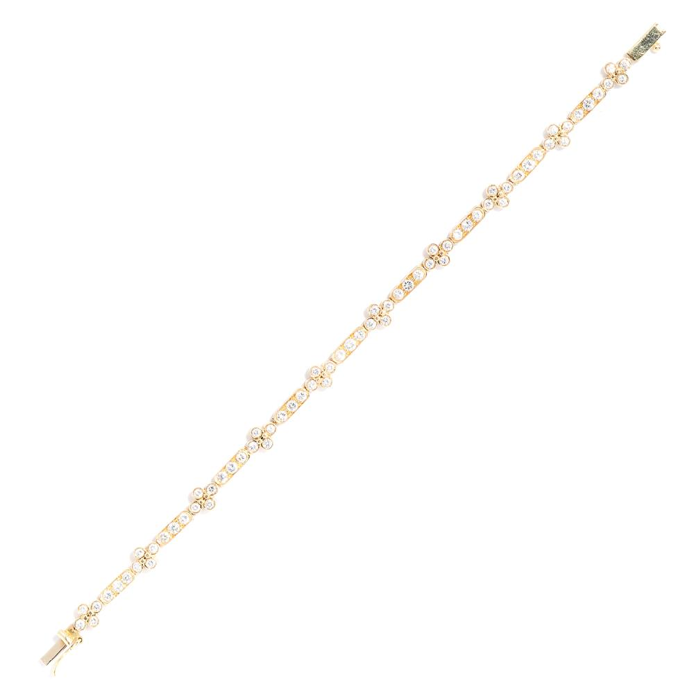 DIAMOND LINE BRACELET in 18ct yellow gold, set with round cut diamonds totalling approximately 3.30 carats, stamped 750, 17.5cm, 11.90g.