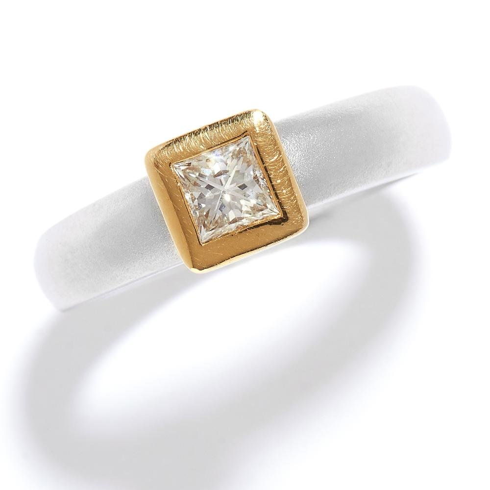 SOLITAIRE DIAMOND ENGAGEMENT RING in 18ct yellow gold and platinum, the princess cut diamond in a yellow gold rub-over mount, to a matte platinum band, full British hallmarks, size L / 5.75, 11.6g.