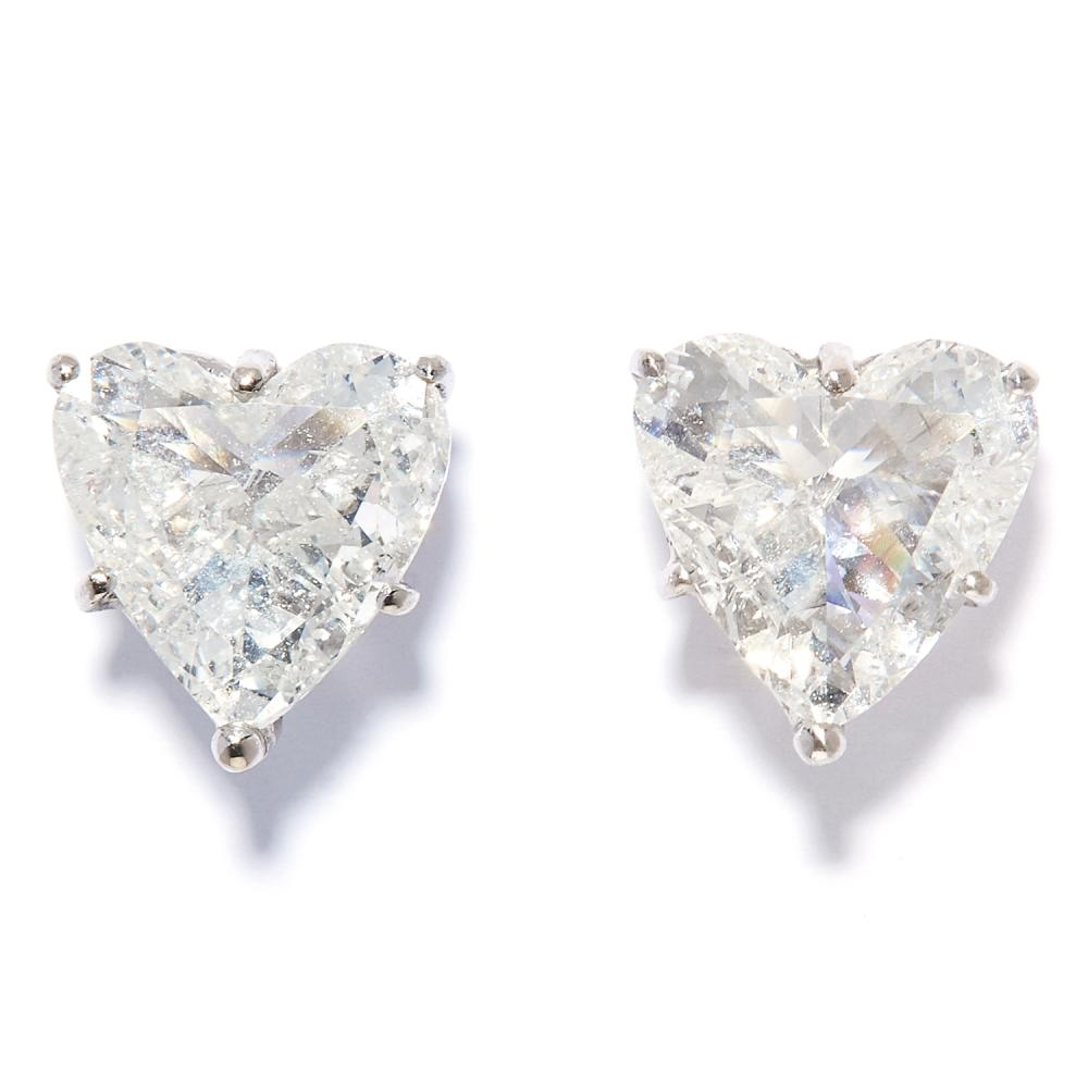PAIR OF 3.15 CARAT HEART DIAMOND STUD EARRINGS in 18ct white gold, each set with a heart cut diamond of 1.60 and 1.55 carats, 1.0cm, 3.0g.