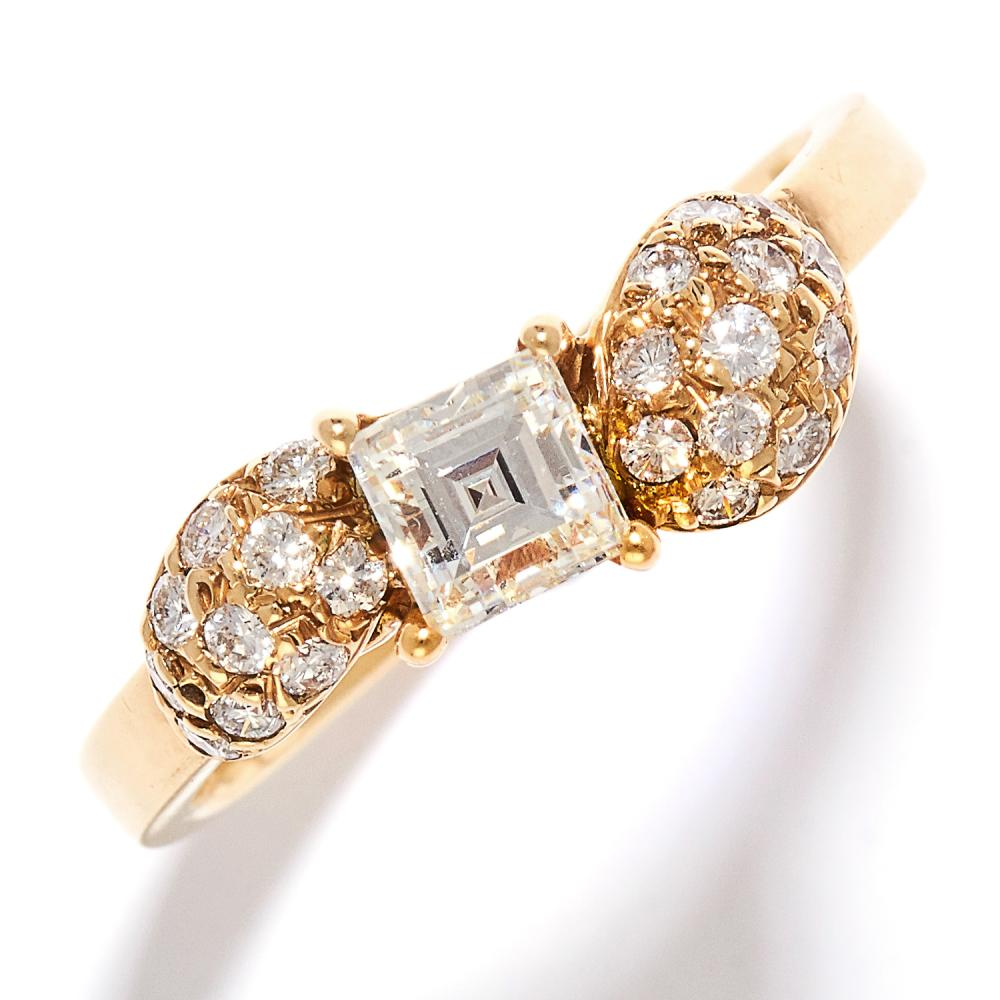 DIAMOND DRESS RING in 18ct yellow gold, set with a square cut diamond of approximately 0.50 carats between further round cut diamonds, stamped 18CT, size O / 7, 3.8g.
