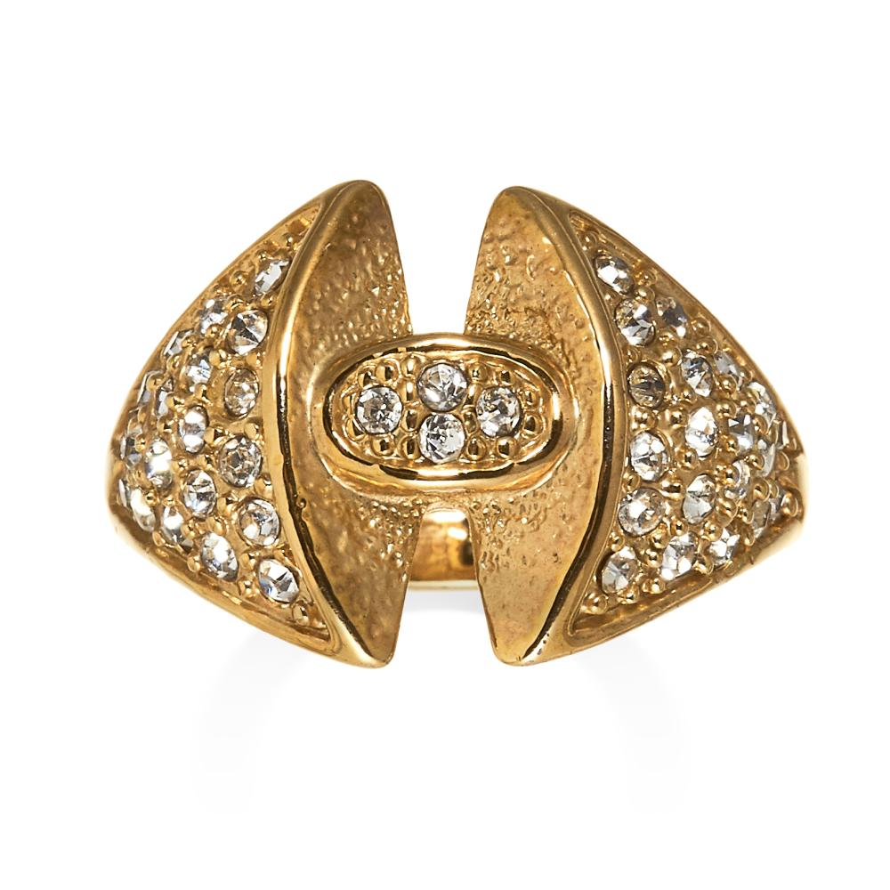 A DIAMOND DRESS RING in high carat yellow gold, the central oval motif set with round cut diamonds, between tapering shoulders further jewelled with round cut diamonds, unmarked, size P / 7.5, 7.2g.