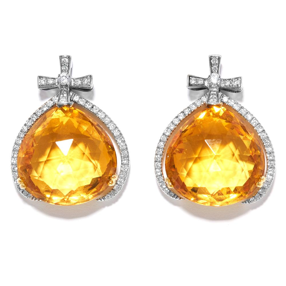 CITRINE AND DIAMOND EARRINGS in 18ct white and yellow gold, the pear shaped citrines suspended within diamond jewelled borders, stamped 750, 2.4cm, 12.7g.
