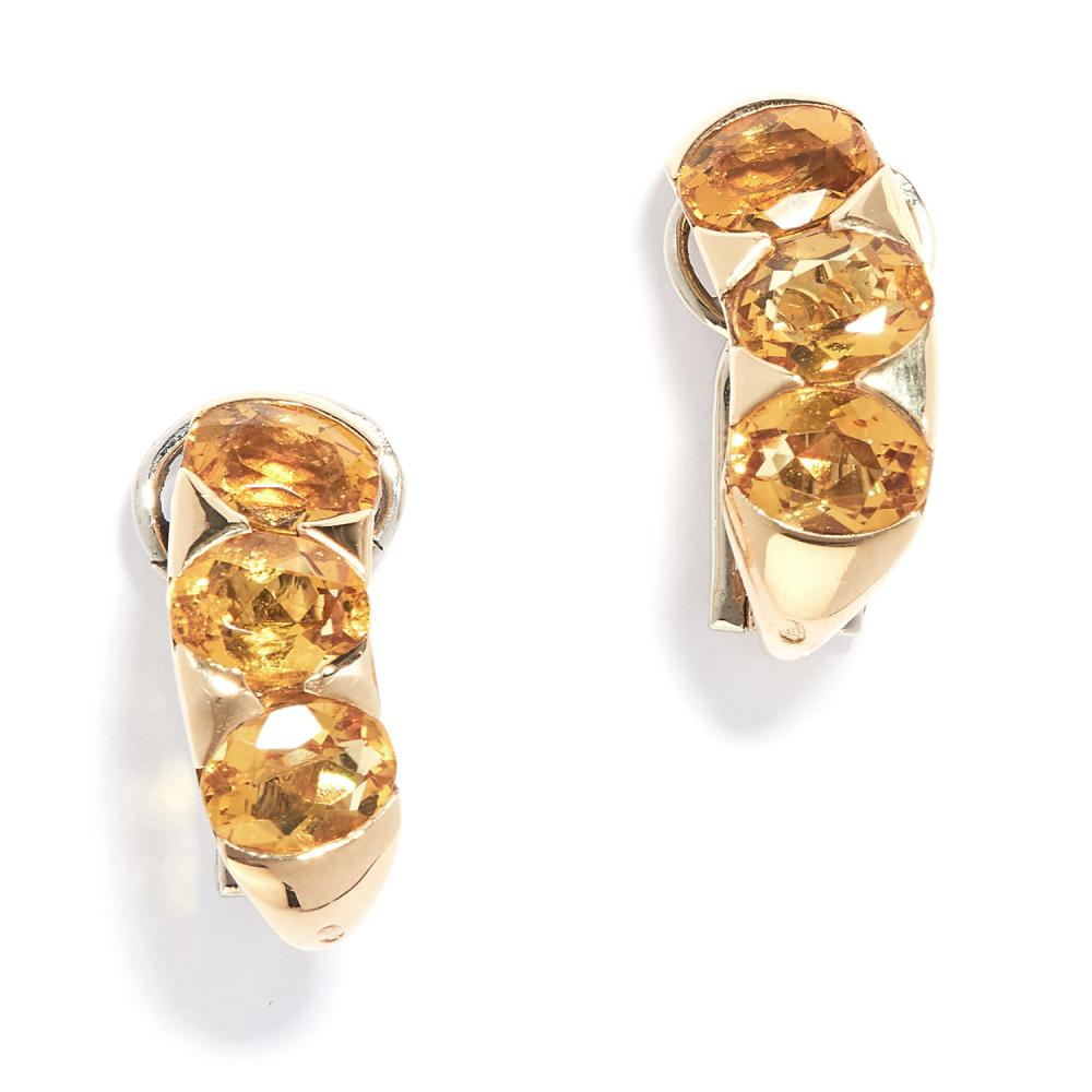 PAIR OF CITRINE CLIP EARRINGS, BULGARI in 18ct yellow gold, the hoop design set with a trio of oval cut citrines, signed BVLGARI, stamped 750, 1.9cm, 9.4g.