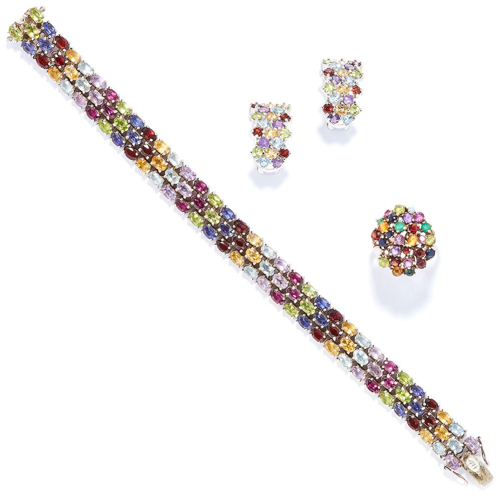 A MULTICOLOUR GEM SET BRACELET, EARRINGS AND RING SUITE in yellow gold and silver, the bracelet and earrings set in silver with rows of oval cut amethyst, citrine, topaz, peridot, garnet, etc, the ring in yellow gold,