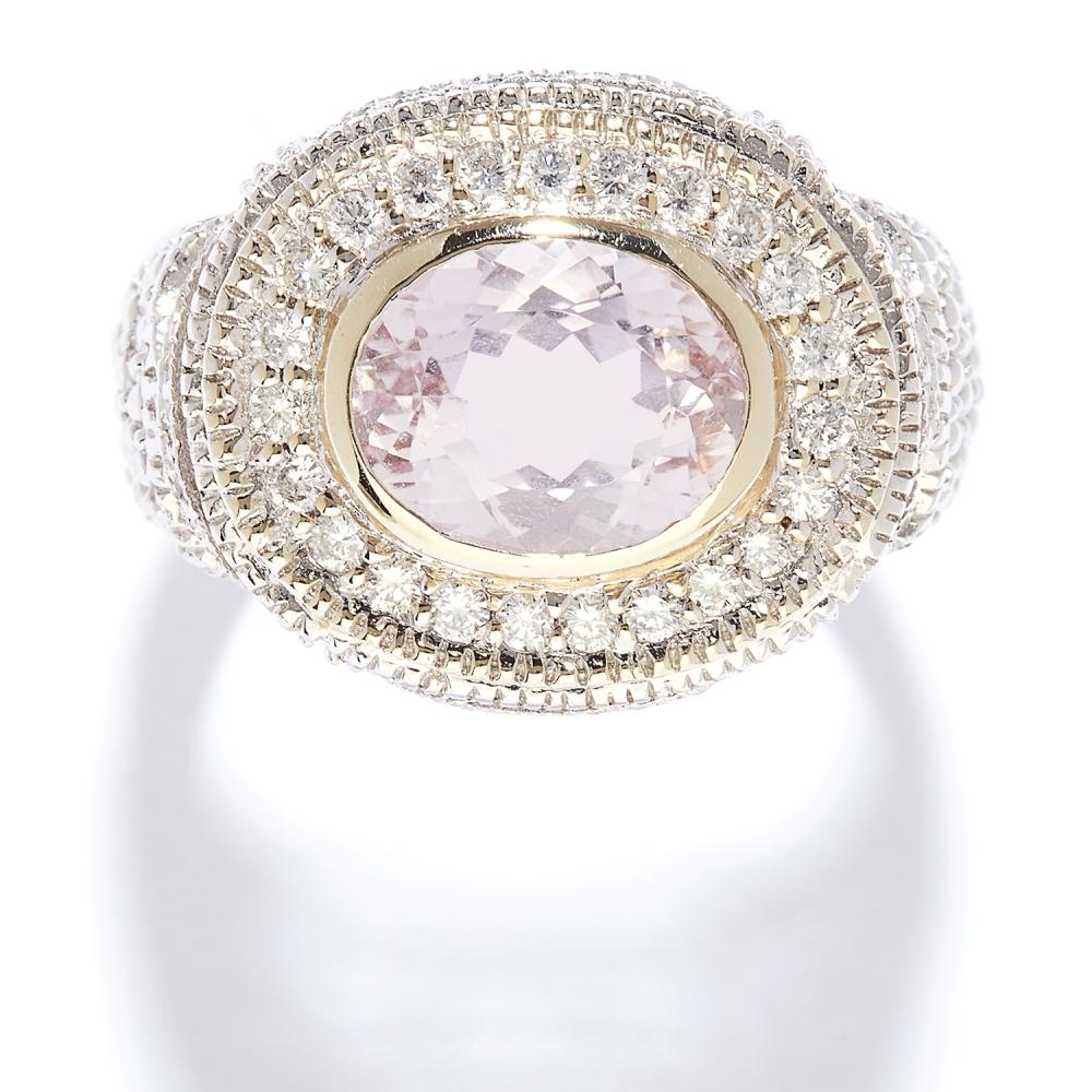 KUNZITE AND DIAMOND RING in white gold, the 2.45 carat oval cut kunzite accented by borders of diamonds, stamped 14K, size N / 7, 7.7g.