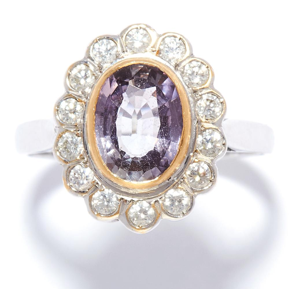 PURPLE SAPPHIRE AND DIAMOND CLUSTER RING in 18ct white gold, set with an oval cut purple sapphire of approximately 1.56 carats in a cluster of round cut diamonds, French assay marks, size Q / 8, 5.2g.