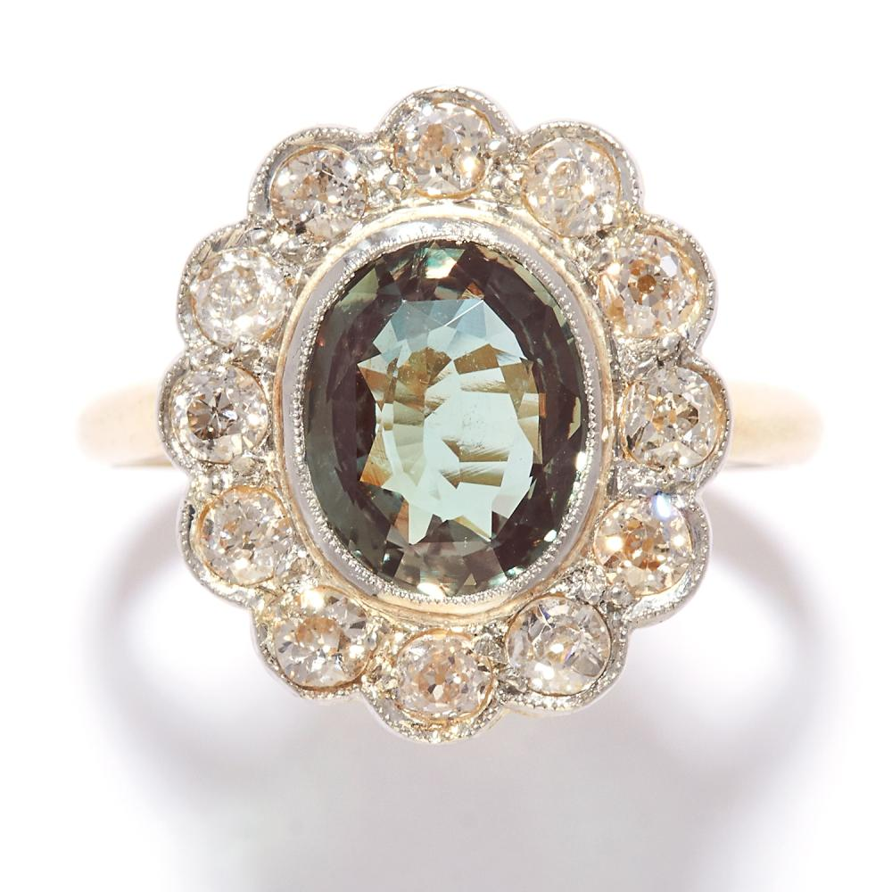 ALEXANDRITE AND DIAMOND CLUSTER RING in high carat yellow gold, the oval cut alexandrite of 2.10 carats in a cluster of round cut diamonds, unmarked, size P / 7.5, 5.1g.
