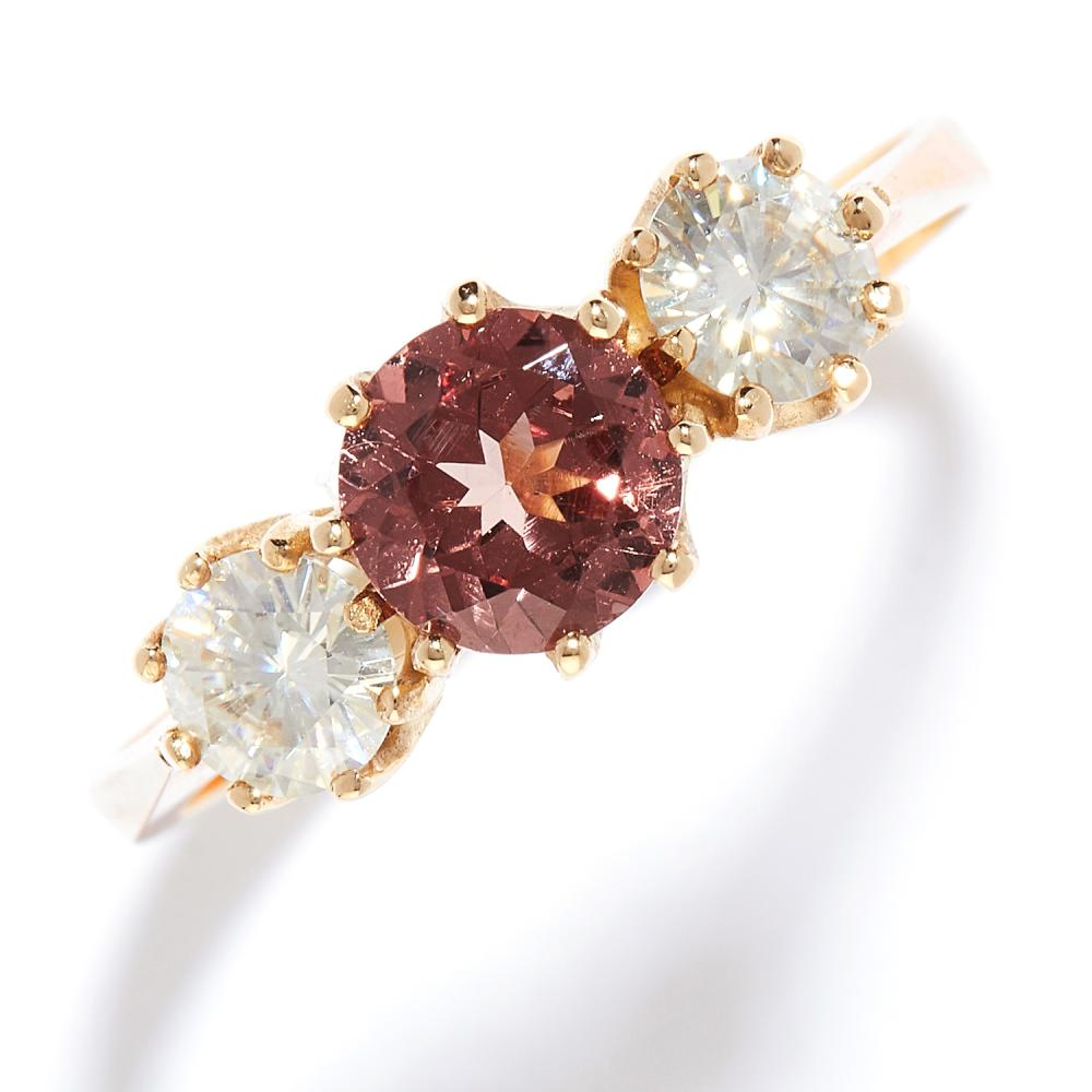 GARNET AND MOISSANITE THREE STONE RING in yellow gold, the round cut pink garnet of 1.0 carats between two moissanites, full British hallmarks, size R / 8.5, 2.8g.