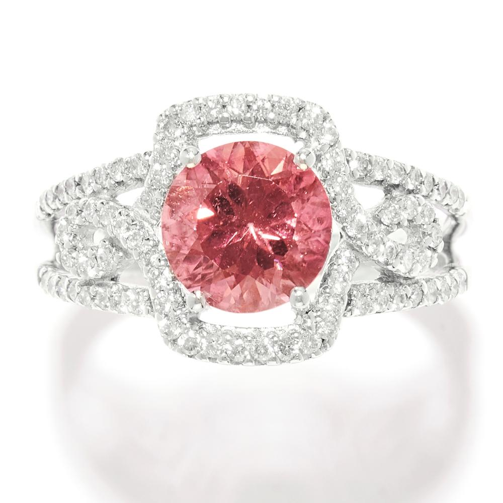 TOURMALINE AND DIAMOND DRESS RING in white gold, set with a round cut pink tourmaline and round cut diamonds, unmarked, size Q / 8, 4.45g.