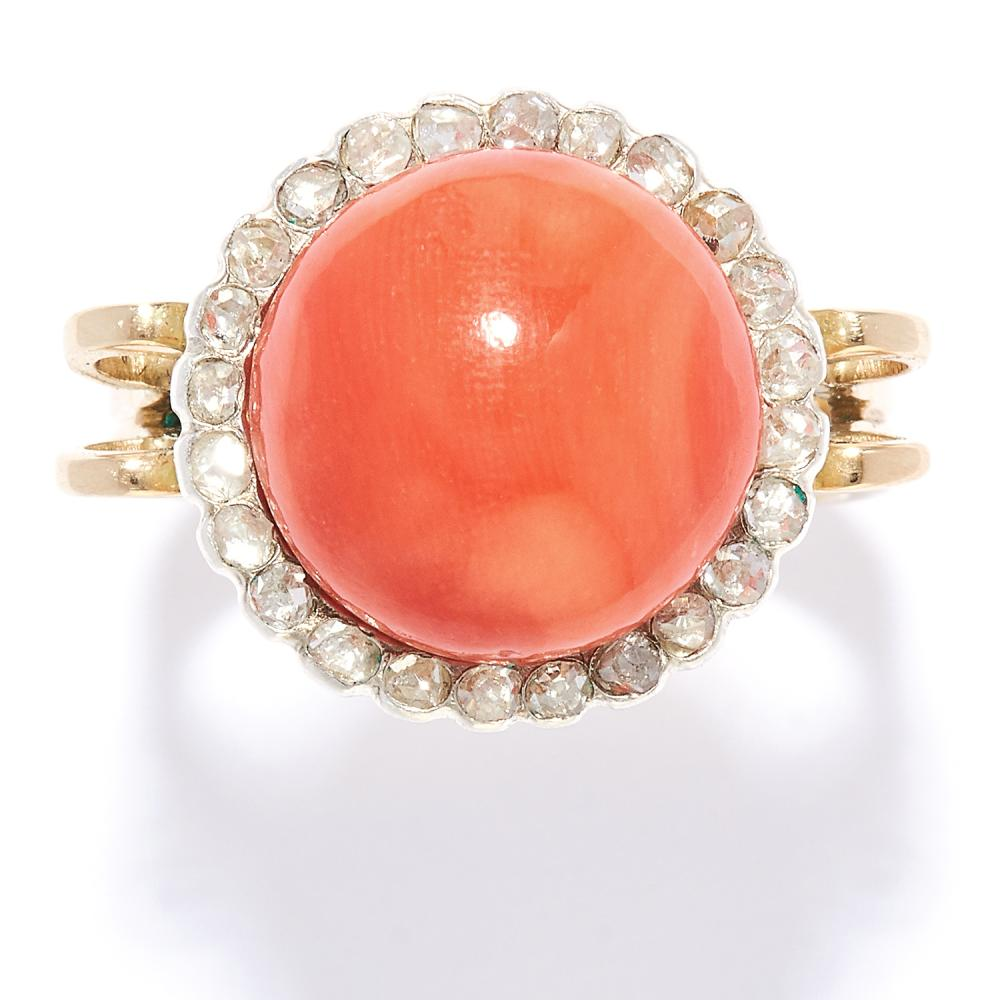 AN ANTIQUE CORAL AND DIAMOND RING in high carat yellow gold, the polished coral bead of 12.5mm within a border of rose cut diamonds, unmarked, size N / 7, 7.0g.
