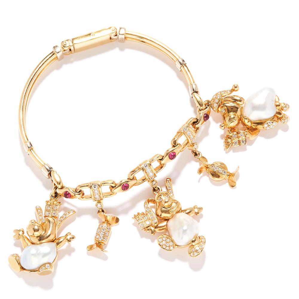 PEARL, RUBY AND DIAMOND CHARM BRACELET in 18ct yellow gold, the fancy link bracelet suspending various jewelled, animal and sweet charms, stamped 18C, 17.5cm, 42.3g.