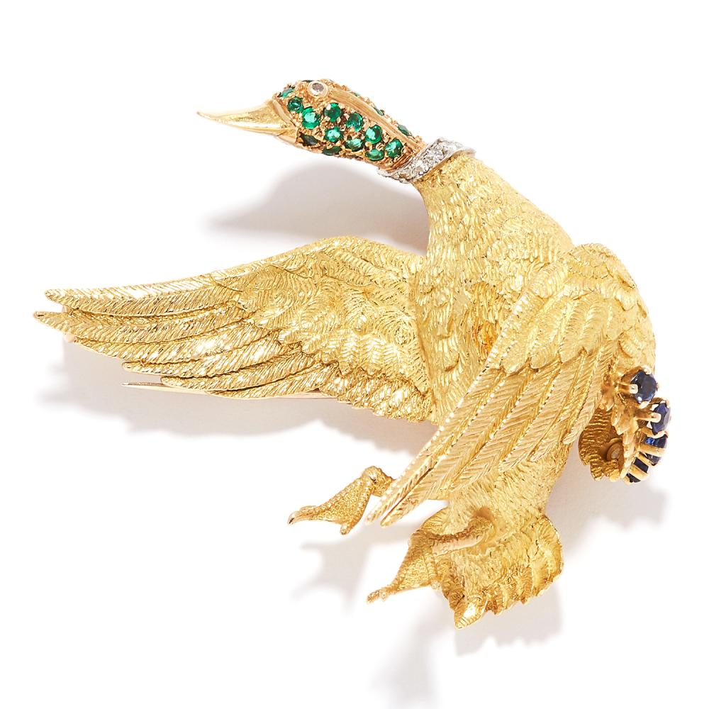 EMERALD, SAPPHIRE AND DIAMOND DUCK BROOCH, GEORGES LENFENT FOR HERMES in 18ct yellow gold, depicting a duck in flight, jewelled with sapphires, emeralds and diamonds, Lenfent maker's mark, signed Hermes Paris and numbered, French marks, 4.7cm, 18.6g.