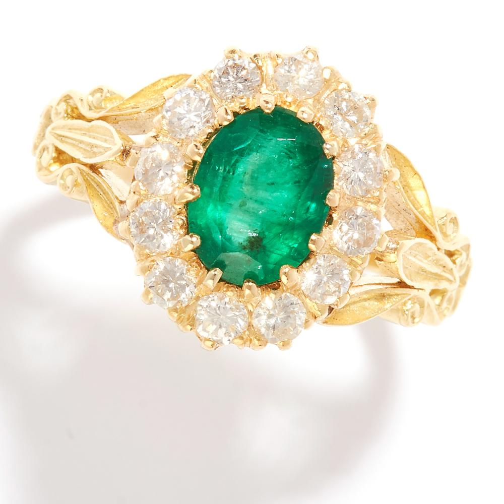 EMERALD AND DIAMOND CLUSTER RING in 18ct yellow gold, set with an oval cut emerald in a cluster of round cut diamonds, marked indistinctly, size N / 6.5, 6.30g.