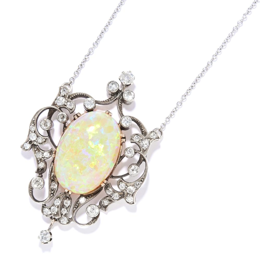 ANTIQUE OPAL AND DIAMOND PENDANT NECKLACE in yellow gold and silver, the oval cabochon opal of 18.56 carats within a scrolling, openwork design jewelled with diamonds, unmarked, 5.6cm, 18.5g.