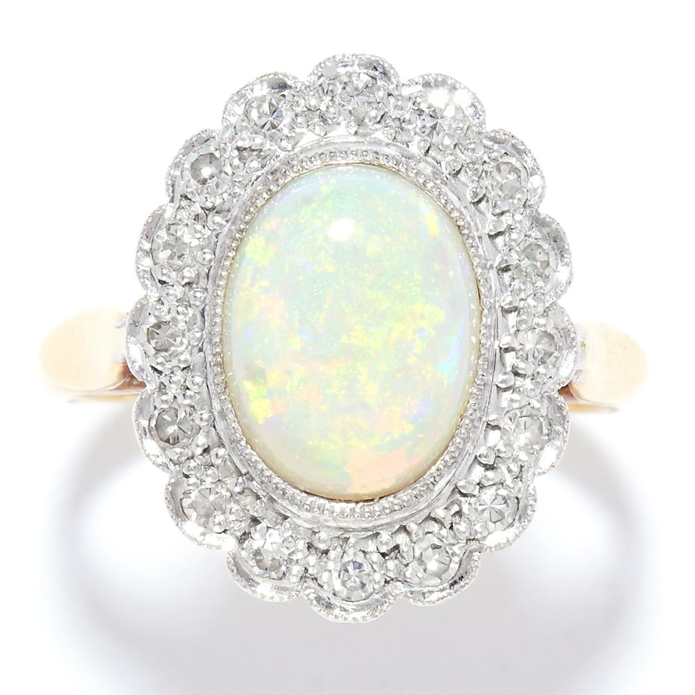 OPAL AND DIAMOND CLUSTER RING in yellow gold, set with a cabochon opal in a cluster of round cut diamonds, marked indistinctly, size K / 5, 4.9g.