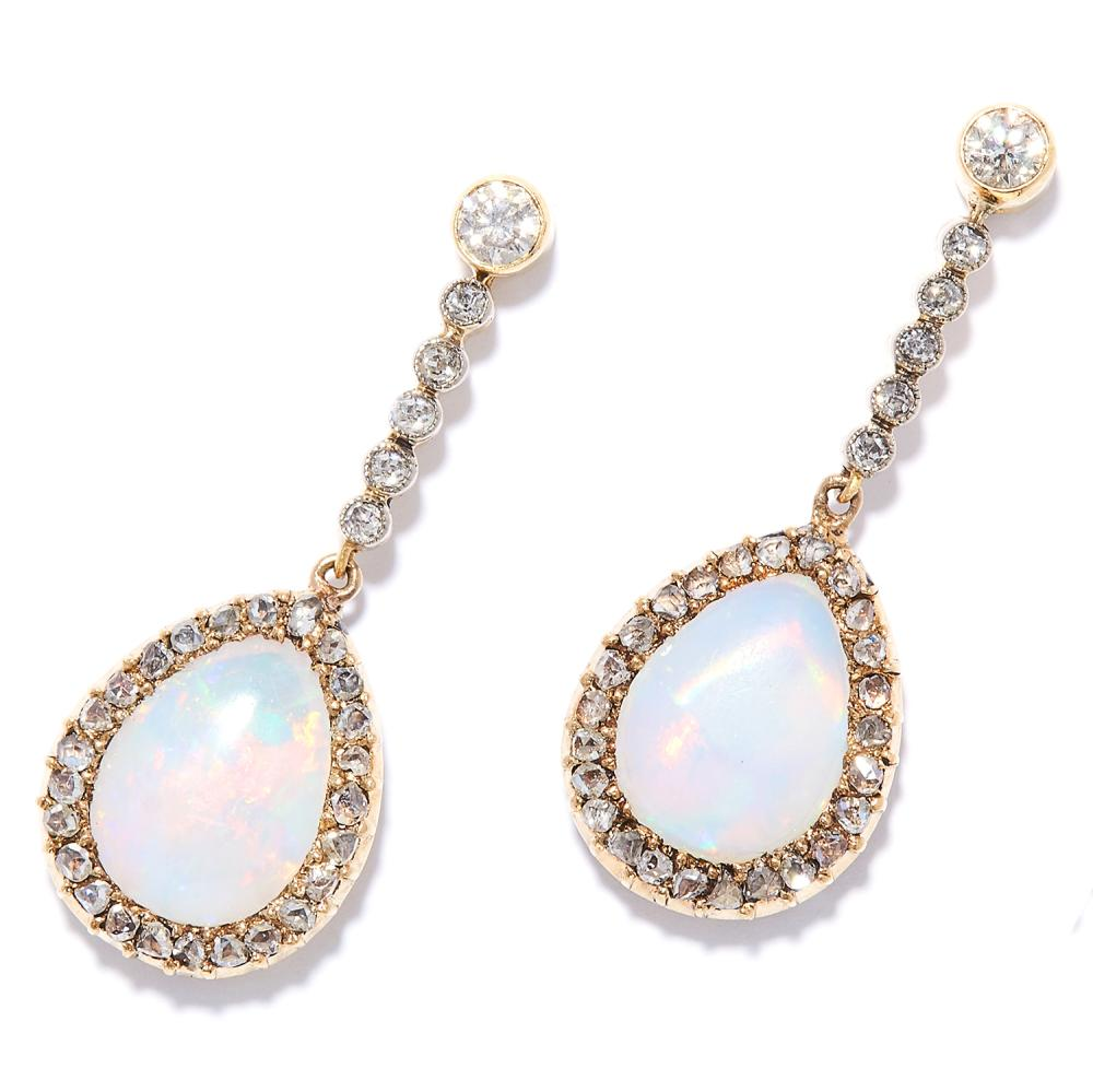 OPAL AND DIAMOND CLUSTER EARRINGS in high carat yellow gold, each set with a row of round cut diamonds suspending a pear cabochon opal in a cluster of rose cut diamonds, unmarked, 3cm, 5.57g.