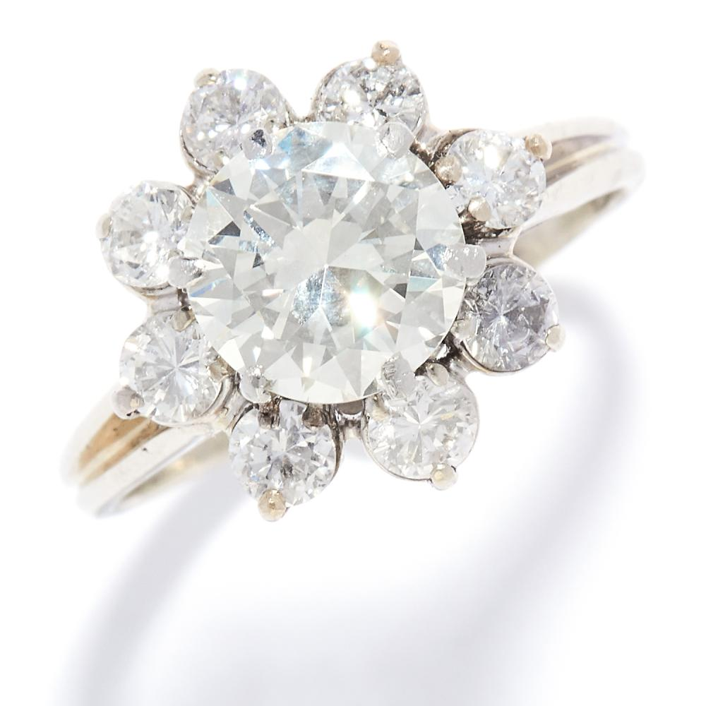 2.31 CARAT DIAMOND CLUSTER RING in platinum or white gold, the central round cut diamond of 1.67 carats encircled by eight further round cut diamonds, marked indistinctly, size N / 6.5, 3.8g.