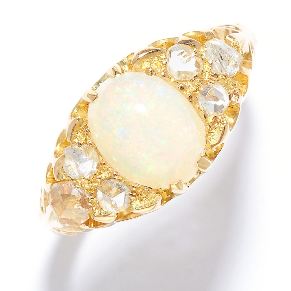 ANTIQUE OPAL AND DIAMOND DRESS RING in high carat yellow gold, set with a cabochon opal and rose cut diamonds, unmarked, size O / 7, 3.57g.