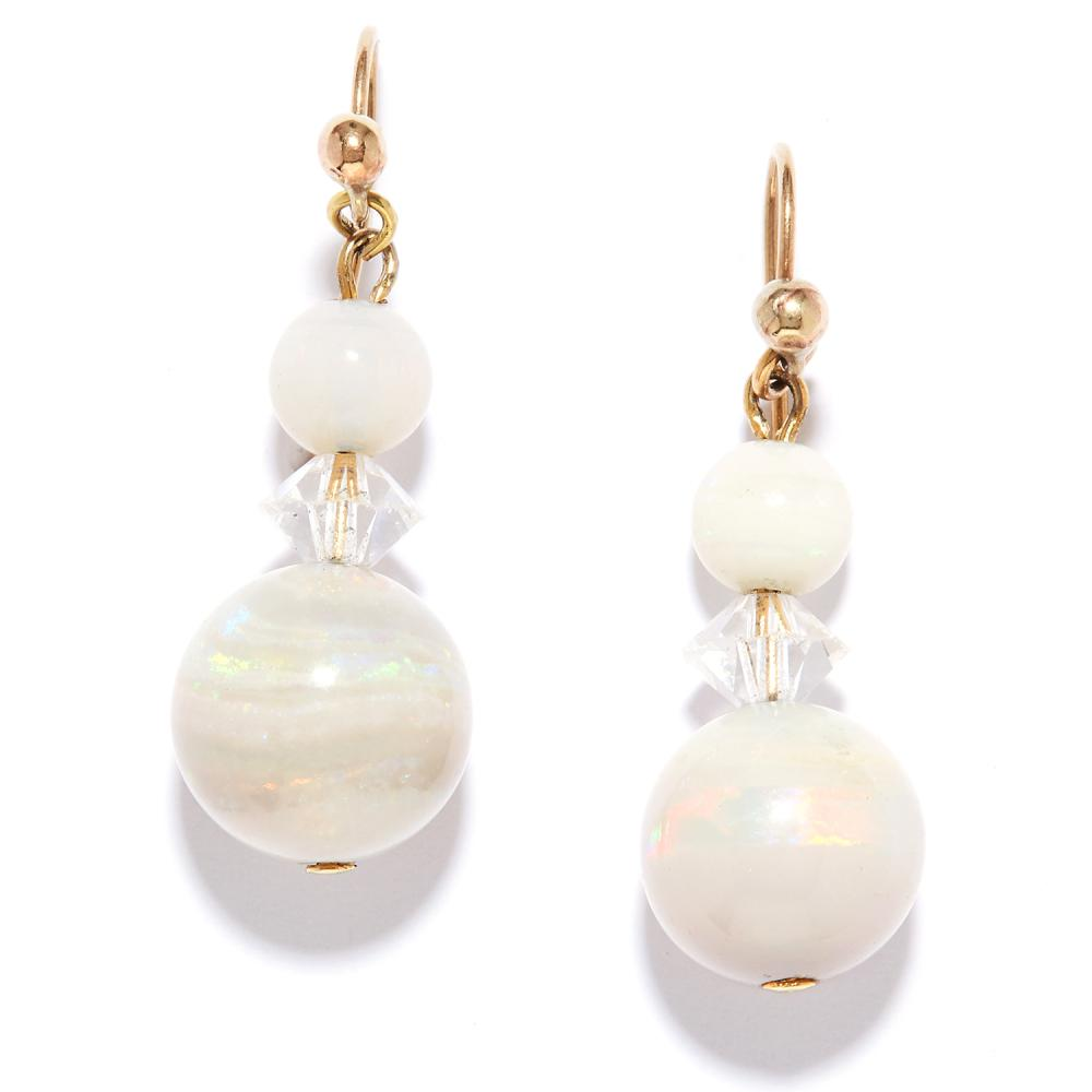 OPAL AND ROCK CRYSTAL DROP EARRINGS in yellow gold, each set with two graduated opal beads with rock crystal spacer, unmarked, 3.0cm, 3.6g.