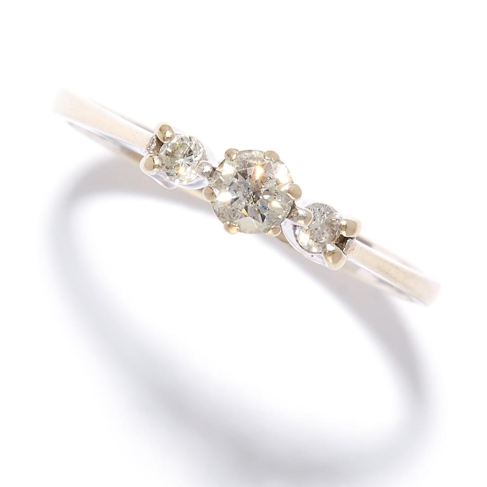 A DIAMOND THREE STONE RING in 18ct white gold, set with three round cut diamonds, stamped 750, size K / 5.5, 1.7g.
