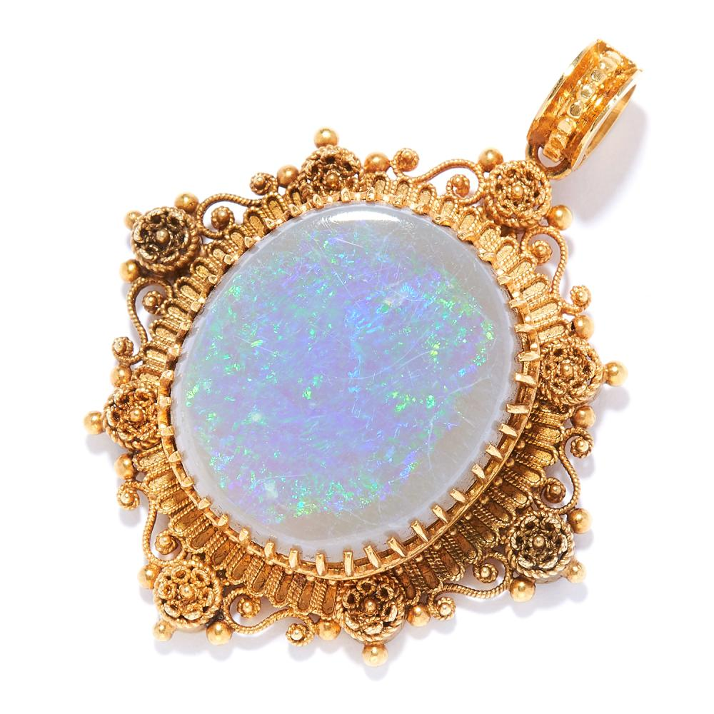 AN ANTIQUE OPAL PENDANT in high carat yellow gold, set with a cabochon opal in gold filigree border, unmarked, 4.0cm, 6.45g.