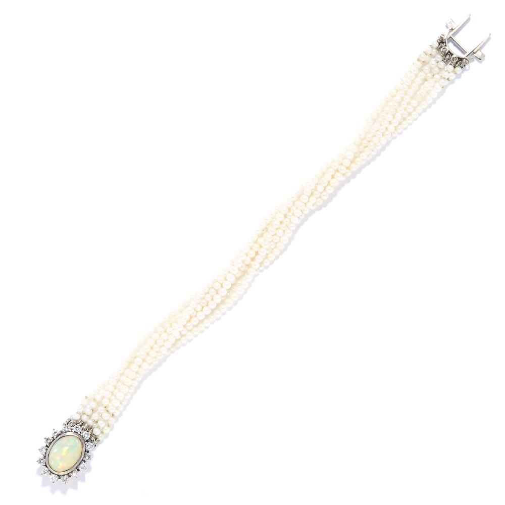 PEARL, OPAL AND DIAMOND BRACELET in white gold or platinum, comprising of seven rows of pearls with a cabochon opal and round cut diamond cluster clasp, unmarked, 18cm, 14.26g.