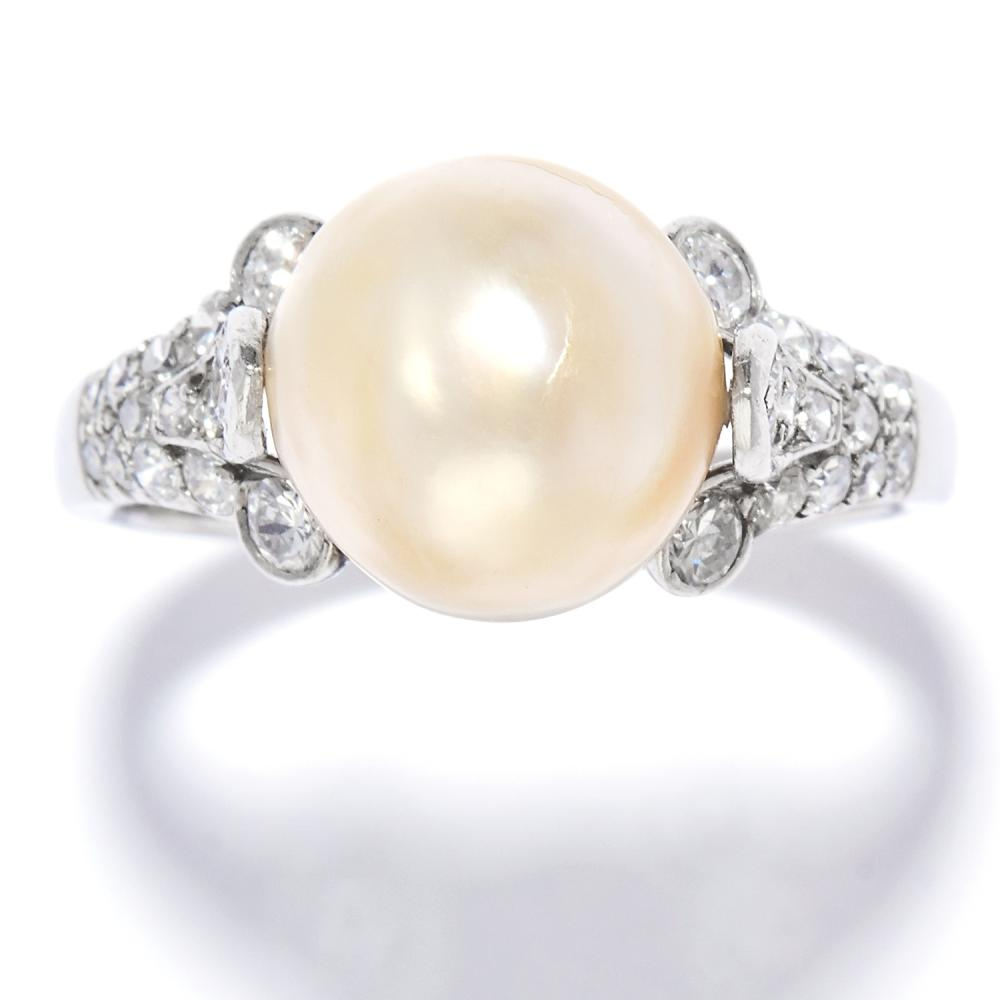 NATURAL PEARL AND DIAMOND RING, BULGARI in platinum, the 10.3mm natural pearl between scrolling diamond set shoulders, signed Bvlgari, French marks, size O / 7, 6.4g. LFG Report: Natural, Saltwater origin.