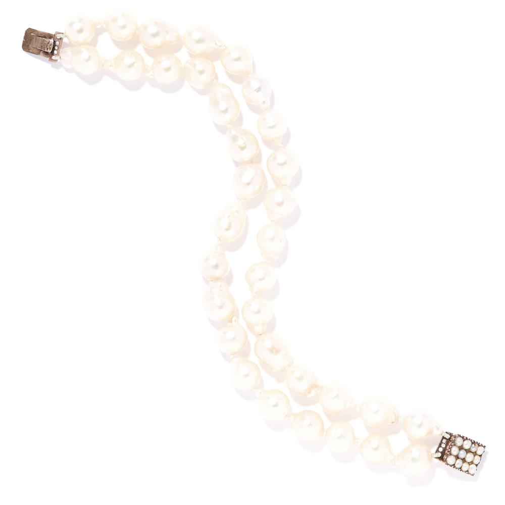 TWO STRAND PEARL BEAD BRACELET in yellow gold, comprising of two rows of baroque pearls on a pearl set clasp, unmarked, 18.5cm, 28.0g.