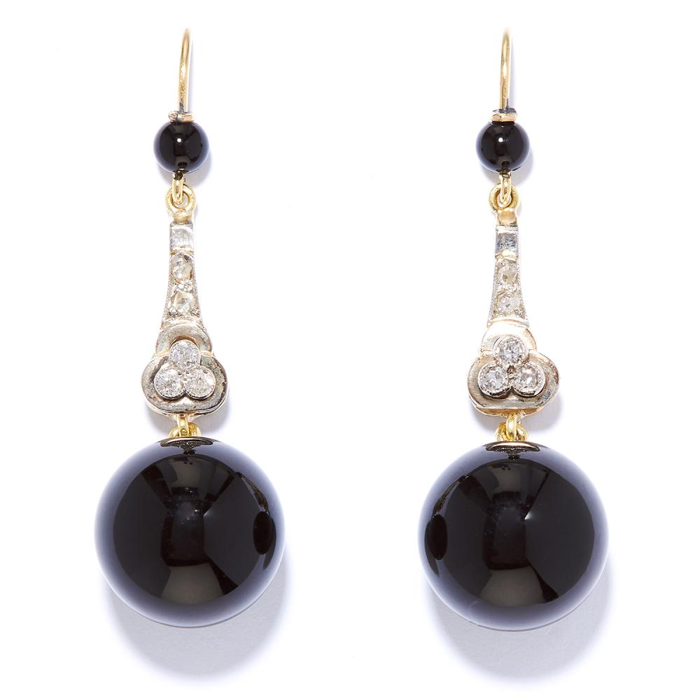 ART DECO ONYX AND DIAMOND DROP EARRINGS in high carat yellow gold and platinum, suspending polished onyx beads below tapering drops jewelled with diamonds, unmarked, 4.6cm, 12.2g.