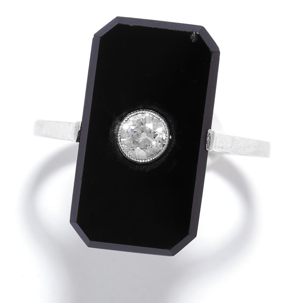 ANTIQUE ONYX AND DIAMOND RING in 18ct white gold, comprising of a polished onyx set with a round cut diamond, stamped 18CT, size O / 7, 3.8g.