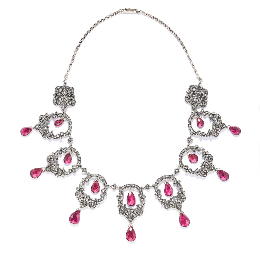 AN ANTIQUE TOURMALINE AND DIAMOND NECKLACE, 19TH CENTURY in yellow gold and silver, openwork design jewelled with diamonds, suspending tourmaline briolettes, unmarked, 45cm, 59g.