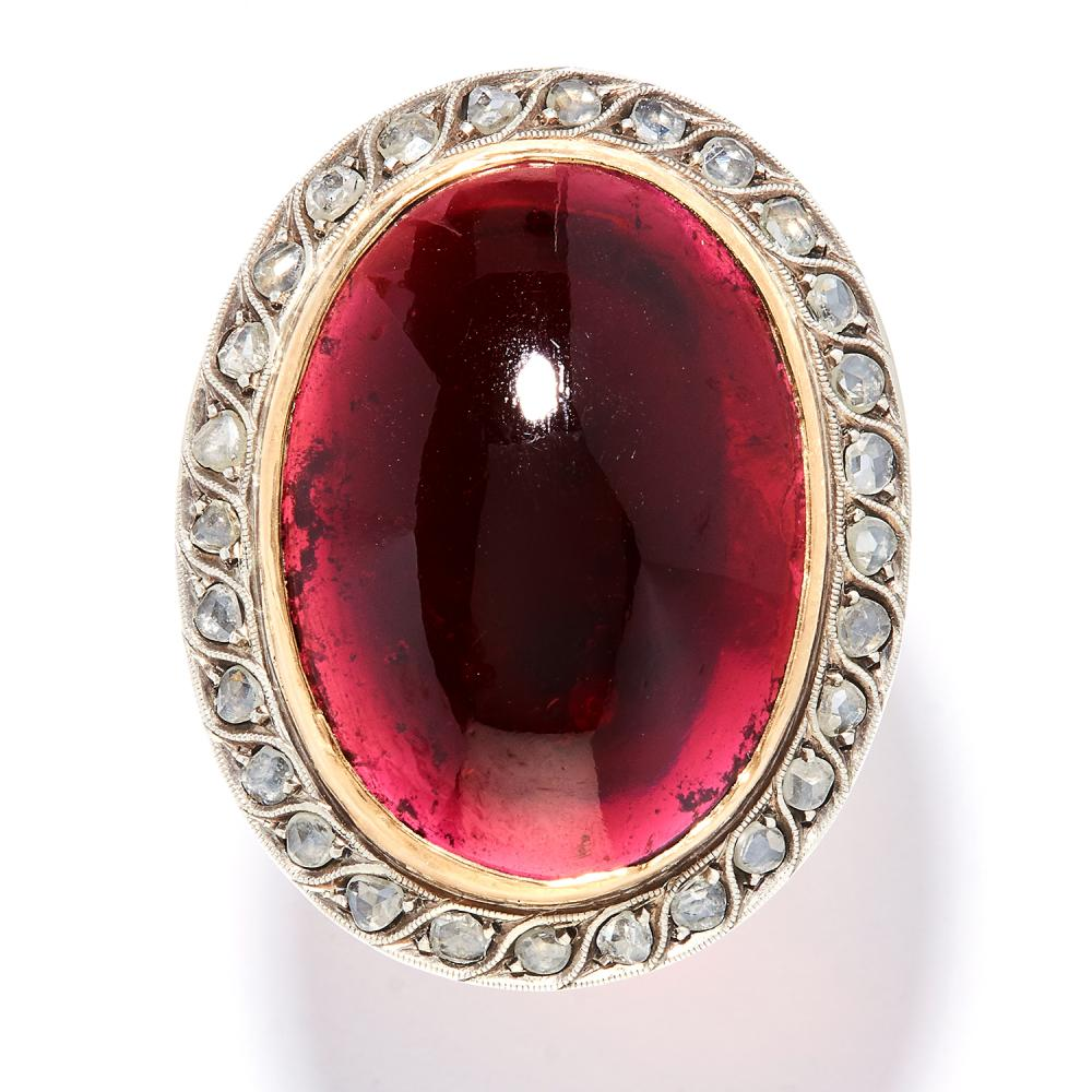 ANTIQUE GARNET AND DIAMOND RING in high carat yellow gold and silver, the large oval cabochon garnet encircled by rose cut diamonds, unmarked, size R / 9, 14.4g.