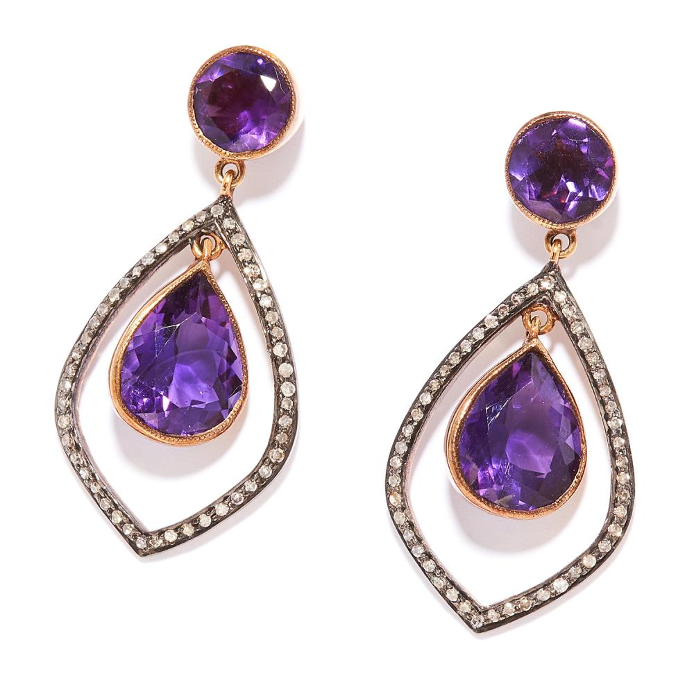AMETHYST AND DIAMOND EARRINGS in silver and yellow gold, pear cut amethysts within diamond halos below amethyst tops, stamped 925 and 585, 4.1cm, 8.6g.