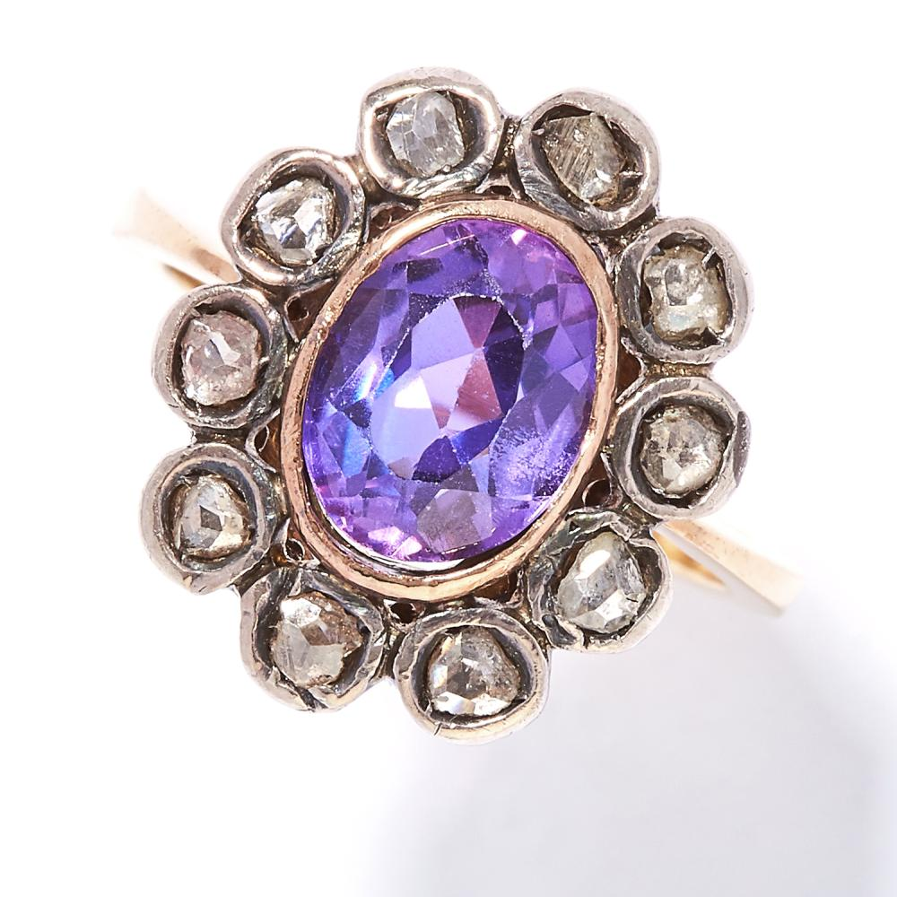 AMETHYST AND DIAMOND RING in yellow gold and silver, oval cut amethyst encircled by rose cut diamonds, unmarked, size M / 6.25, 5.3g.