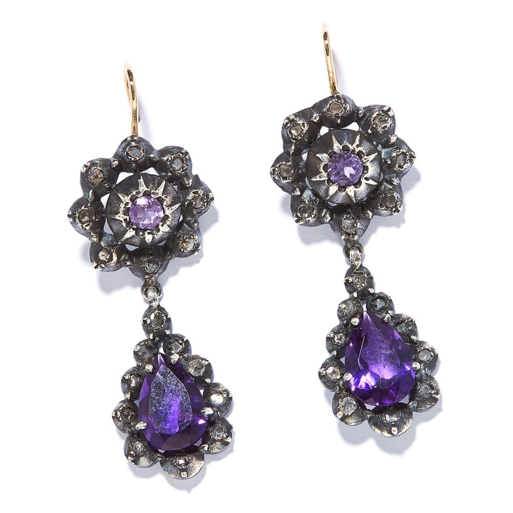 AMETHYST AND DIAMOND EARRINGS the articulated bodies with amethysts encircled by rose cut diamonds, unmarked, 5.1cm, 11.9g.
