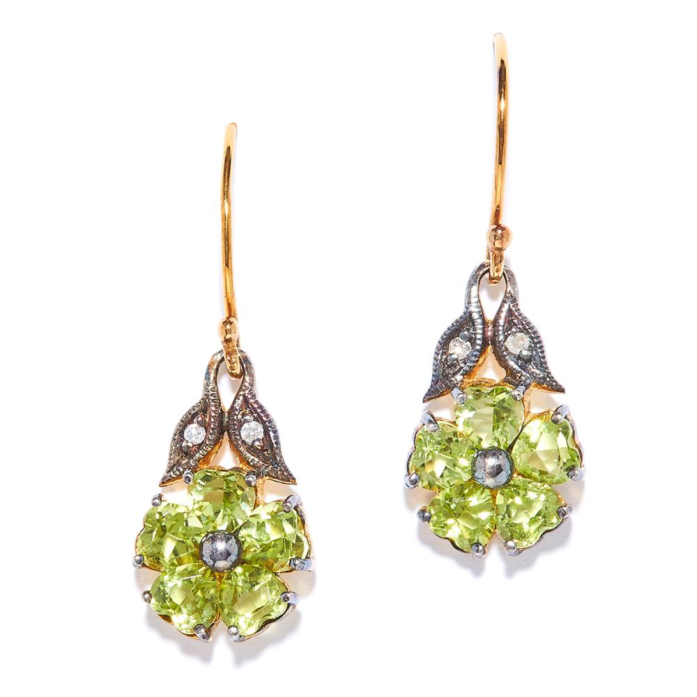 PERIDOT AND DIAMOND EARRINGS the flower design set with peridot below diamond accents, unmarked, 2.7cm, 2.5g.