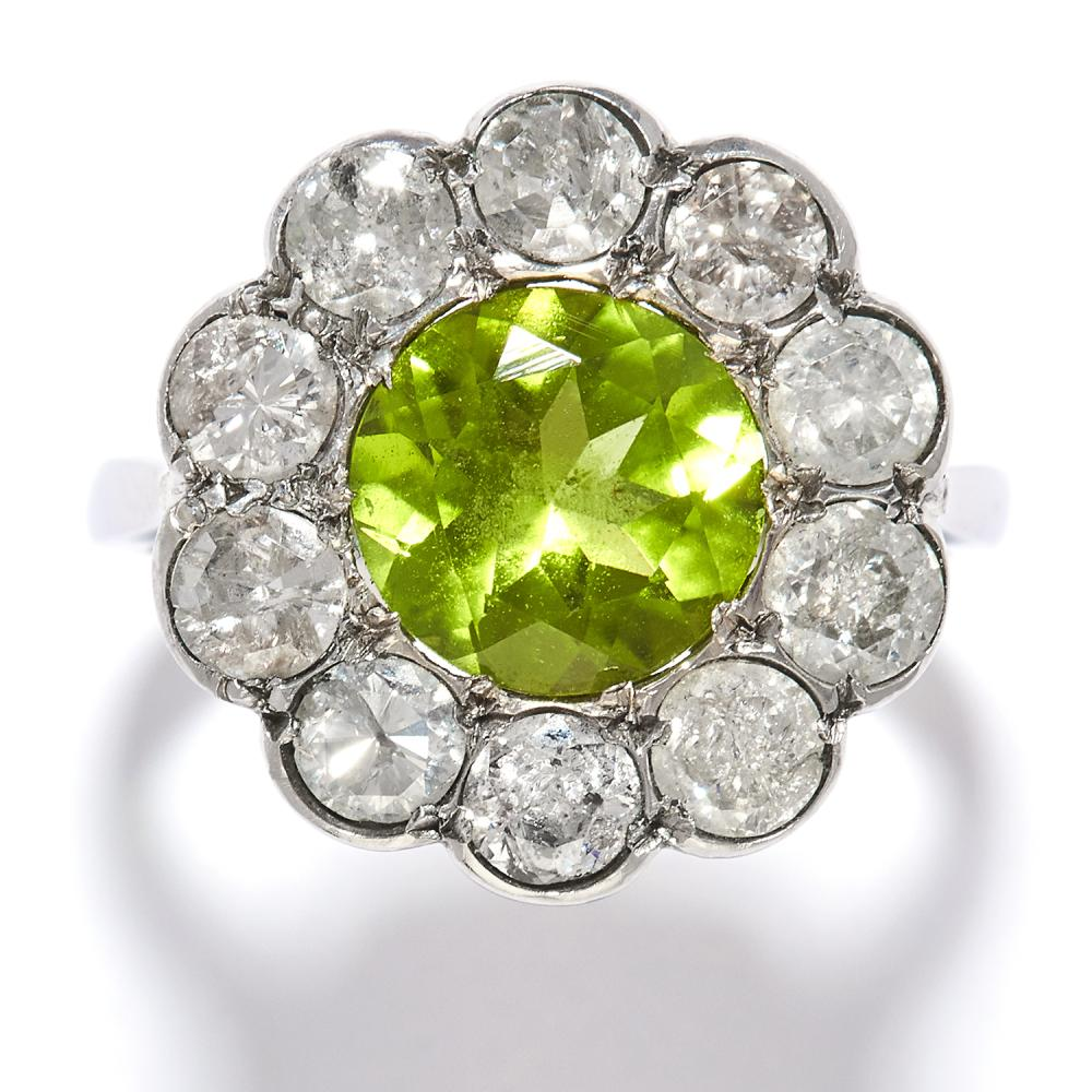 PERIDOT AND DIAMOND CLUSTER RING in platinum or white gold, the round cut peridot encircled by brilliant cut diamonds, unmarked, size M / 6.25, 6.8g.