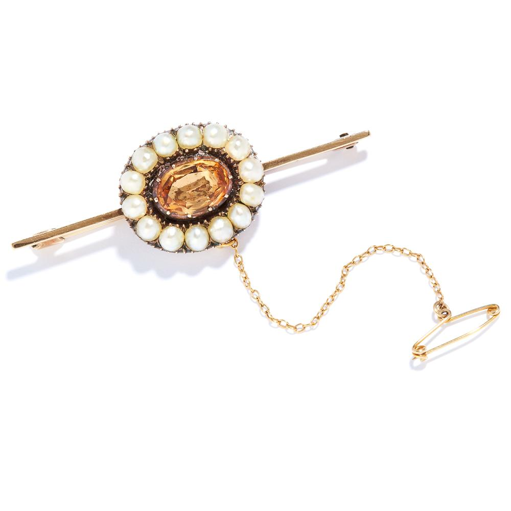 ANTIQUE IMPERIAL TOPAZ AND PEARL BAR BROOCH in high carat yellow gold, set with an oval cut topaz in a border of seed pearls, unmarked, 5.3cm, 7.12g.