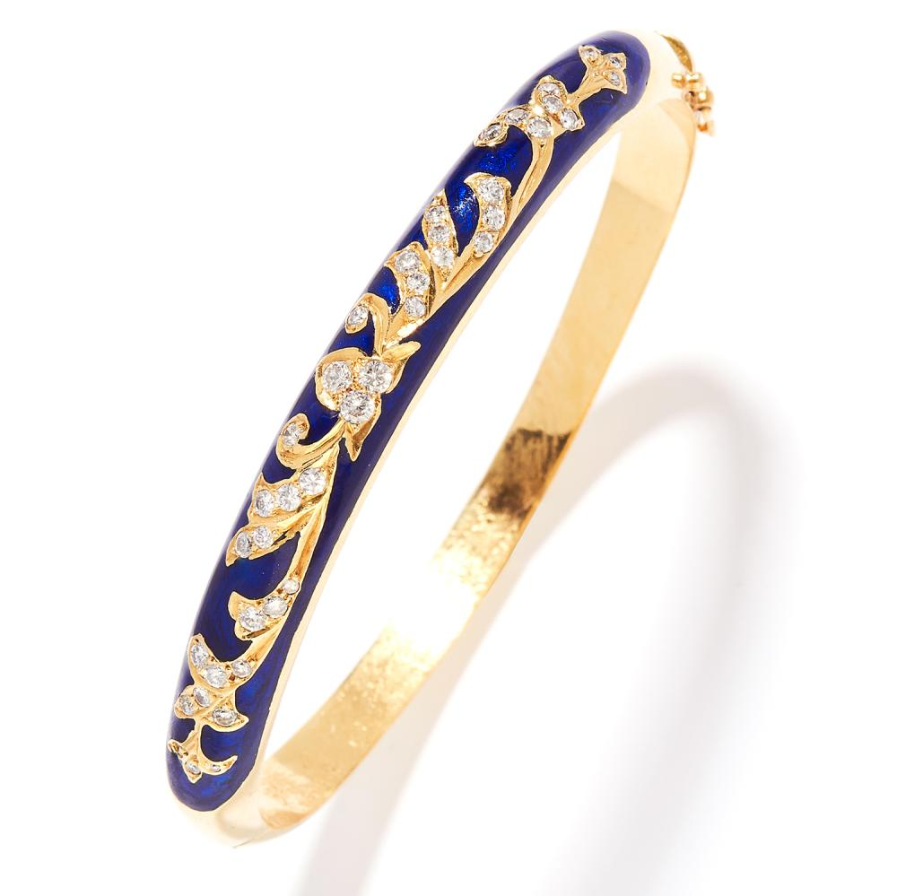 DIAMOND AND ENAMEL BANGLE in 18ct yellow gold, the graduated, rounded hoop jewelled with round cut diamonds in floral motifs, within a dark blue enamel ground, French marks, inner diameter 5.8cm, 25.9g.