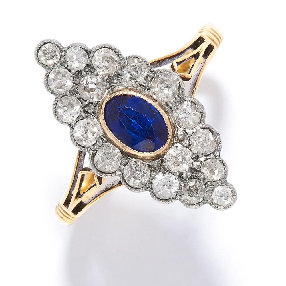 SAPPHIRE AND DIAMOND RING in high carat yellow gold, the marquise face is set with an oval cut sapphire and old cut diamonds, marked indistinctly, size N / 7,3.32g.