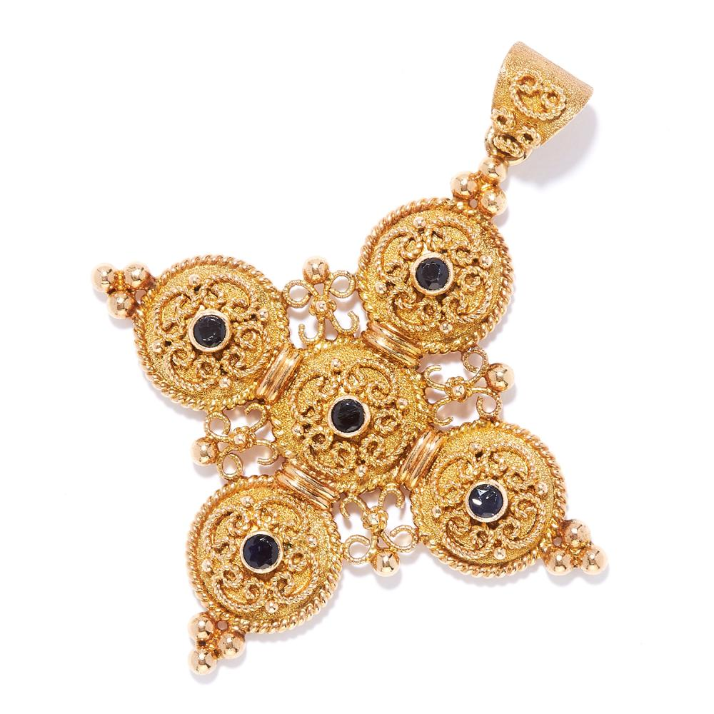 ANTIQUE SAPPHIRE CROSS PENDANT in 18ct yellow gold, comprising of a cross set with five round cut sapphires in scrolling gold wirework, stamped 750, 5.2cm, 11.92g.