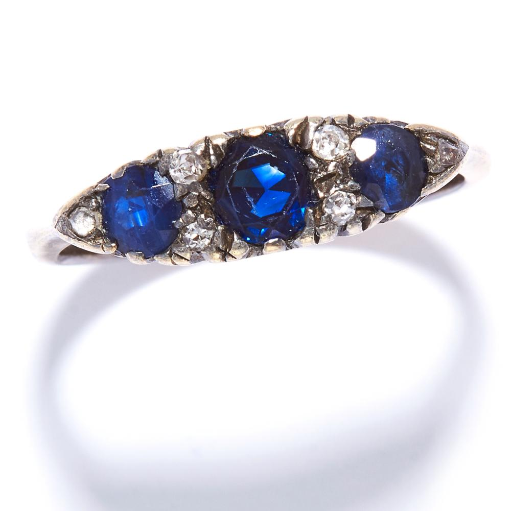 A SAPPHIRE AND DIAMOND DRESS RING in yellow gold, set with three round cut sapphires and alternating round cut diamonds, unmarked, size R / 8.5, 2.6g.